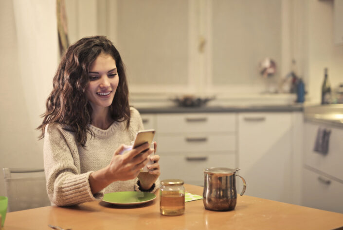 Woman smiling over something on her phone