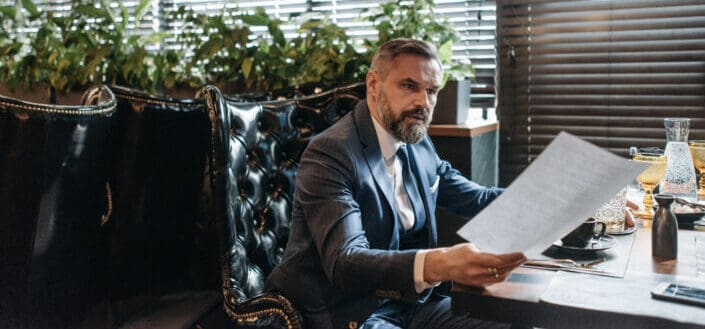 Businessman Reviewing Some Documents