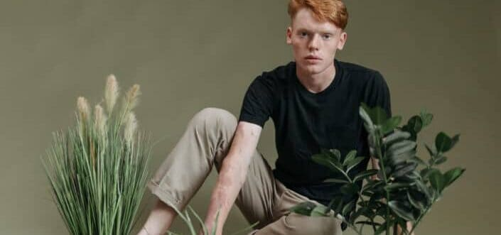 model man posing with a plant