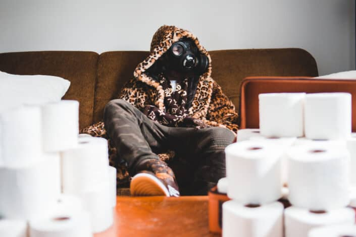 Masked-man sitting on a sofa