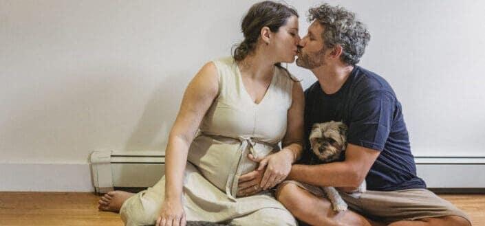 Loving pregnant couple kissing