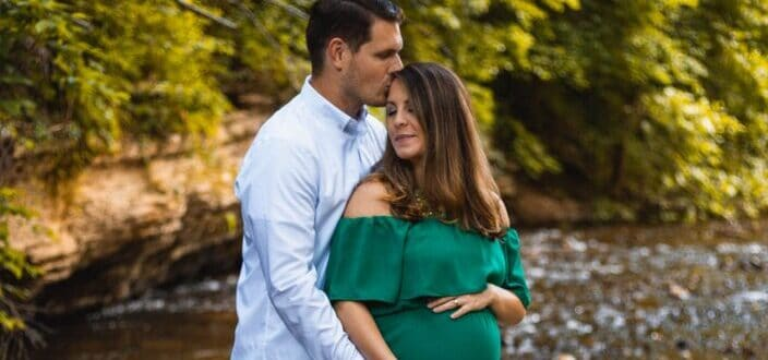 creekside backlit couple in love maternity pictures