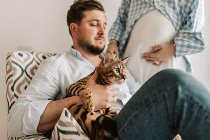 husband holding a cat