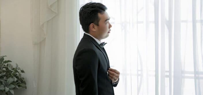 Man in tuxedo Standing Near Window