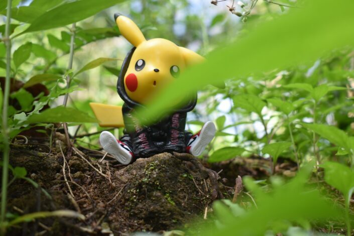 pikachu plush toy on brown tree trunk